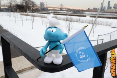 NEW YORK, NY - MARCH 18: A Smuf holding a UN flag at the United Nations Headquarters celebrating International Day of Happiness in conjunction with SMURFS: THE LOST VILLAGE on March 18, 2017 in New York City. (Photo by Cindy Ord/Getty Images for Sony Pictures)
