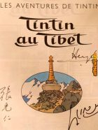 Front page of the comic The adventures of Tintin - Tintin au Tibet signed by the author Herge and the Dalai Lama-afnews