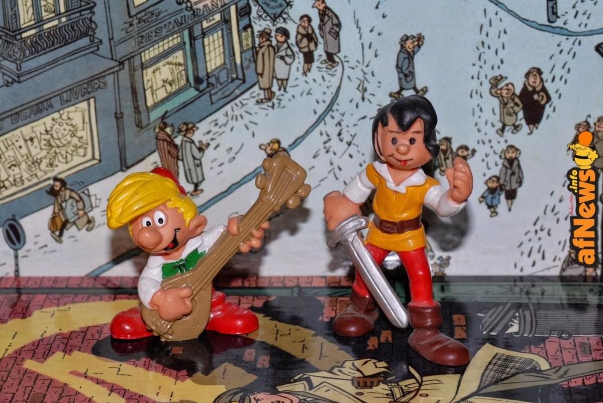FumettoSuFumetto, serie fotografica di Gianfranco Goria. John e Solfamì (Johan et Pirlouit di Peyo) su copertina de Il Marchio Giallo di Jacobs e sfondo dal bel volume Les Noëls de Franquin (ed. Marsu).