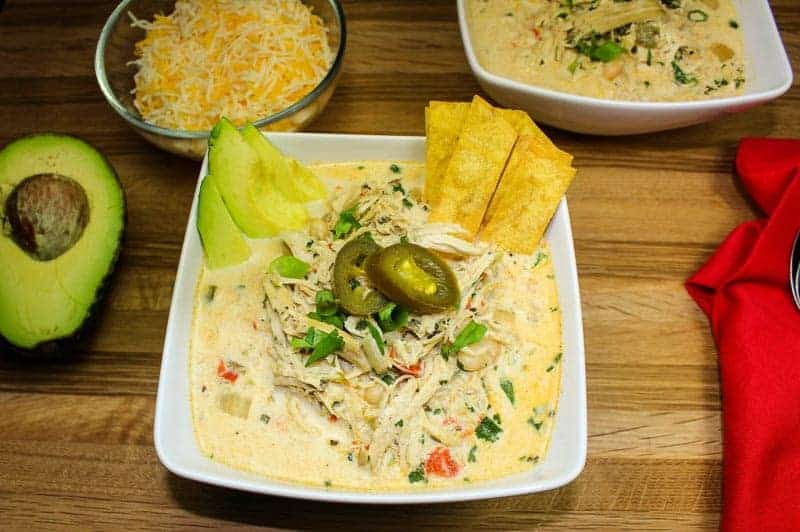 Slow Cooker Jalapeno Popper Chicken Chili has all the great flavors of the beloved party dip without the guilt. Slow cooked chicken mixed with a creamy broth, white beans, and cream cheese! Not too spicy with just the right kick