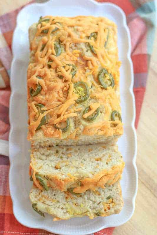 ThisEasy Cheesy Jalapeno Beer Bread Recipe makes some of the best homemade bread that can be made in the kitchen. With a moist center, a crunchy cheesy outer crust, and a salty, slightly sweet and spicy flavor; this bread is delicious by the slice or used for a gourmet sandwich!