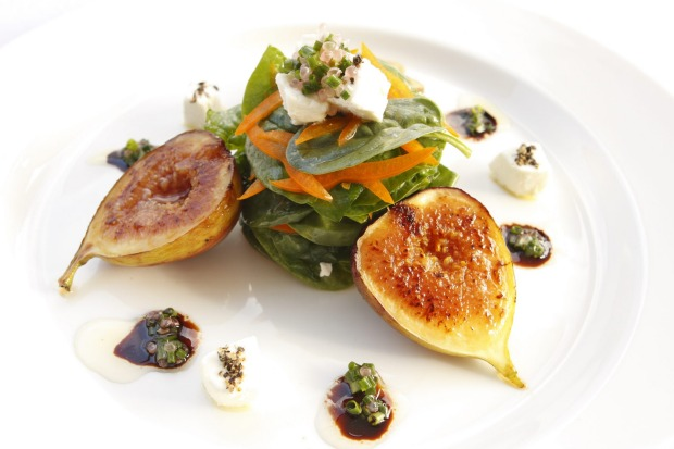 The Sanctuary Byron Bay meal of caramelised figs with baby spinach yellow pepper goats cheese & fingerlime salad with a balsamic reduction.