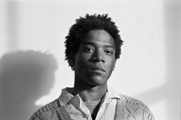 Jean-Michel Basquiat, photographed in 1984. Like a DJ, Basquiat mixed eclectic material - Beethoven, boxing, comics - to create something fresh.