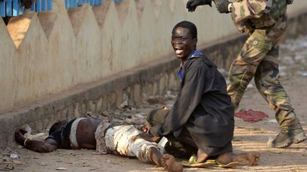 A-man-reacts-next-to-a-demonstrator-who-was-shot-near-the-international-airport-in-Bangui-AFP