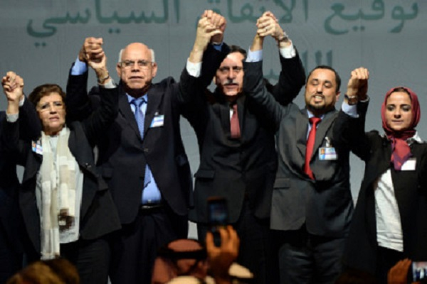 "Libya's General National Congress (GNC) deputy president Saleh al-Makhzoum (2ndR), the new national government head, Prime Minister, Fayez al-Sarraj (C) and the head of the Tobruk-based House of Representatives Mohamed Ali Shoeb (2ndL) celebrate after signing a deal on a unity government on December 17, 2015, in the Moroccan city of Skhirat. Rival Libyan politicians signed a deal on a unity government despite opposition on both sides, in what the United Nations described as a ""first step"" towards ending the crisis. AFP PHOTO / FADEL SENNA / AFP / FADEL SENNA"