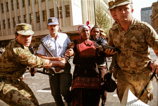 Johannesburg, Sputh Africa 1990-1993: Winnie Mandela, the wife of African National Congress leader Nelson Mandela is arrested by police in downtown Johannesburg during a protest. Photo / Joao Silva.