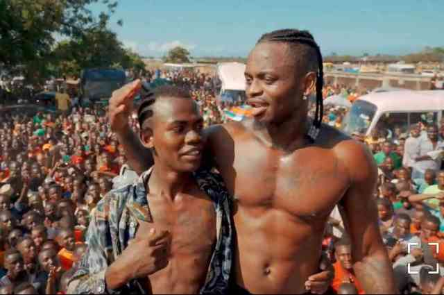 Diamond Platnumz with fan who tattooed him on chest and neck