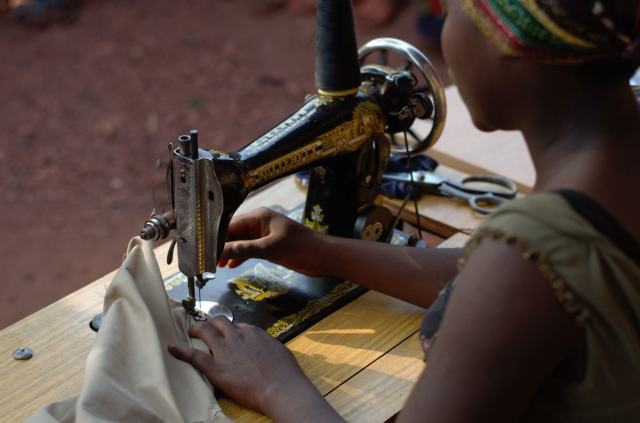 Now 16 and too old for primary school, Elisabeth is learning how to sew.