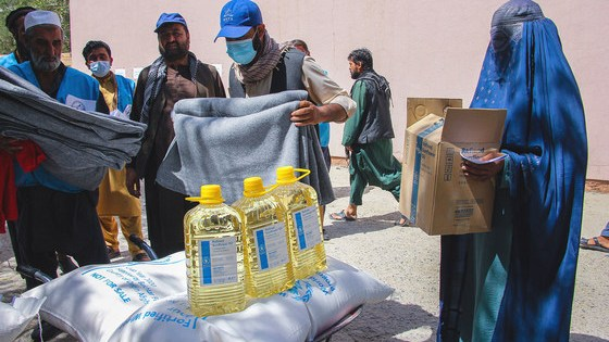 Food and blankets are handed out to people in need in Kabul, the capital of Afghanistan