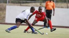 Felix Mochama of KCA University (left) vies for the ball with Kennedy Siblieche (right) of Kenya Police during their Kenya Hockey Union Premier league match at City Park Hockey Stadium on October 9, 2016. PHOTO | MARTIN MUKANGU | NATION MEDIA GROUP