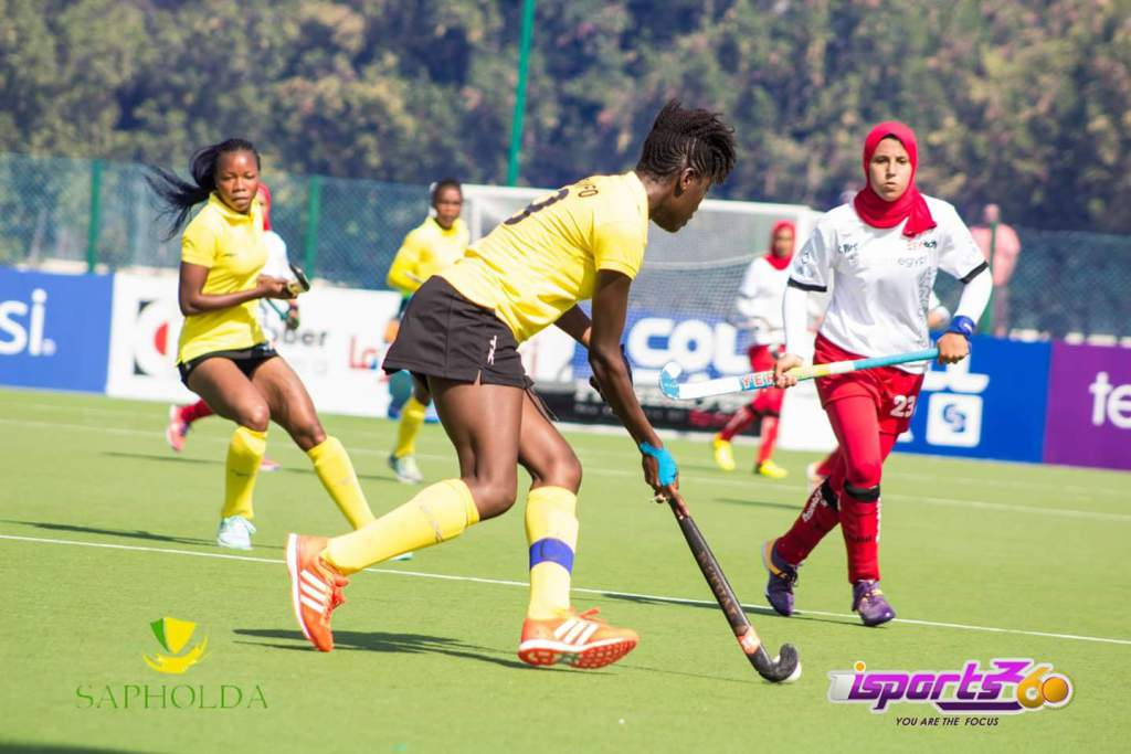 Ghanaian skipper trying to go past her Egyptian counterpart