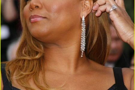 Queen Latifah wows in elegant crimson gown as she and Denzel Washington are recognized at American Black Film Festival Honors