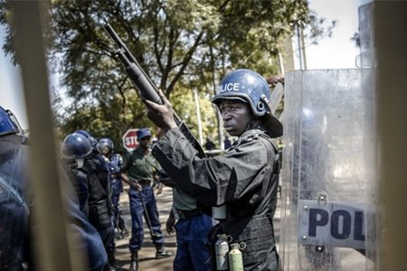 Uneasy silence in Harare streets after Zimbabwe's military moves in, guns firing