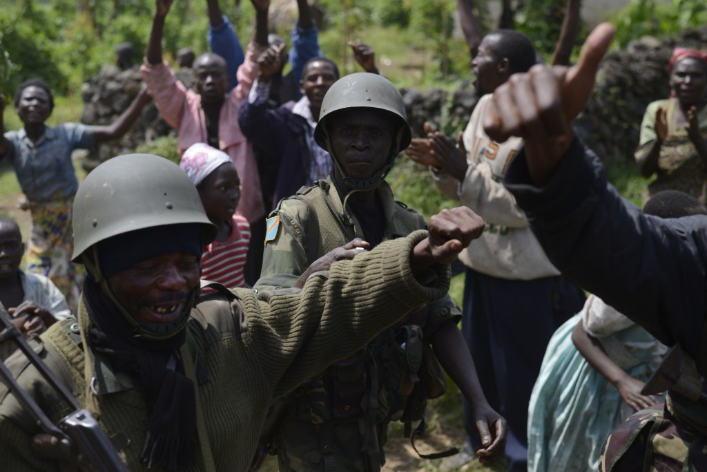 In Rugare on the way to Rumangabo last Monday (28 October). The army marched to Rumangabo from Kibumba which fell in the early hours of the morning without any resistance and to cheering crowds lining the streets. [JOSEPH KAY]