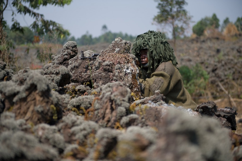 A Congolese army soldier with the FARDC takes up position near Mutahao, several kilometres from Goma in the east of the Democratic Republic of the Congo on July 15, 2013. The army was pushing back M23 rebels for the first time in over a year of the rebellion. [PHIL MOORE]