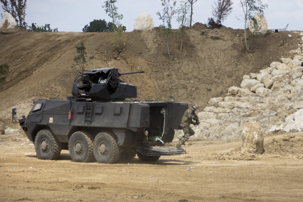 A Renault Defence Trucks VAB Mark III deploys troops while providing cover fire from its TRT -25 turret (made by the IST division of BAE South Africa).
