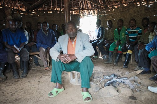 The Lukweti 'Barza' is the meeting place for the elders of the village. Mzee Massomo, in the middle, is the former Chef of Lukweti. He ceded his position to his grandson but continues to be listened to within the Barza. He claims to have been born in 1922. Lukweti, Masisi territory, August 2013. ALEXIS BOUVY/Local Voices