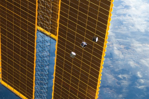 Several tiny CubeSat satellites are shown in this image photographed by an Expedition 33 crew member on the International Space Station on 4 October 2012. By NASA.