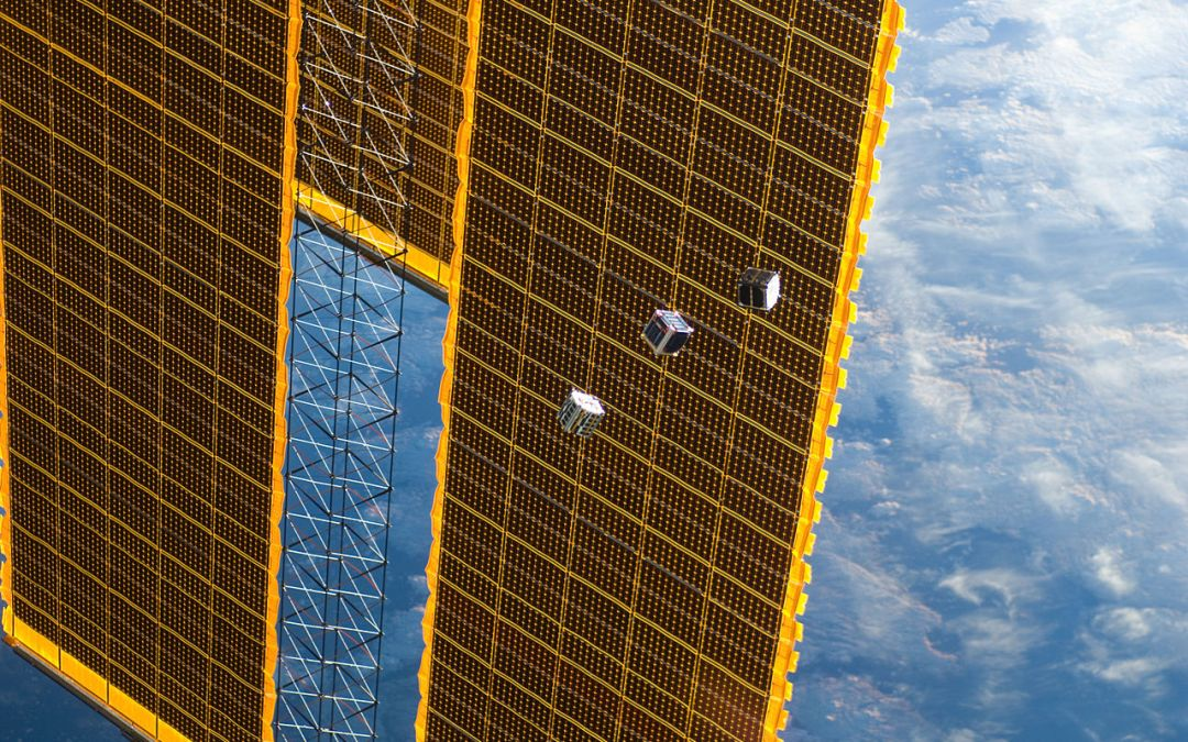 Several tiny CubeSat satellites are shown in this image photographed by an Expedition 33 crew member on the International Space Station on 4 October 2012. The satellites were released outside the Kibo laboratory using a Small Satellite Orbital Deployer attached to the Japanese module's robotic arm. Japan Aerospace Exploration Agency astronaut Aki Hoshide, flight engineer, set up the satellite deployment gear inside the laboratory and placed it in the Kibo airlock. The Japanese robotic arm then grappled the deployment system and its satellites from the airlock for deployment. A portion of the station's solar array panels and a blue and white part of the earth provide the backdrop for the scene. By NASA.