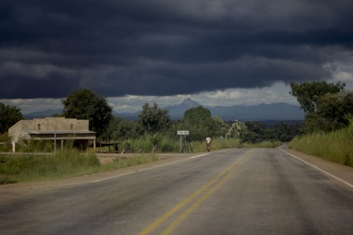 The road to Juba, with storm clouds in the distance.  Despite the rains ending, a rebel advance on the capital is improbable. RICHARD STUPART/ADR