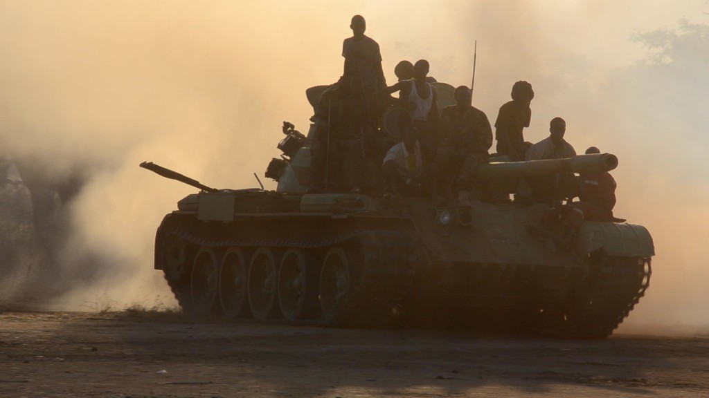 SPLA-N soldiers ride atop a tank during during battle in Dalkoka, Sudan, on December 11th, 2012. uba Reports