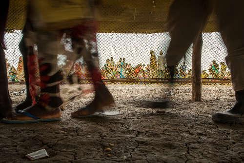 Nuovi arrivati al centro di registrazione nel PoC di Bentiu. Foto di Brendan Bannon. Bentiu, Sud Sudan. Settembre 2015.