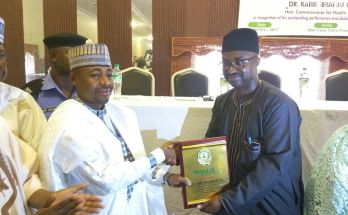 Kano State Health Commissioner Kabir Getso (L) receiving the Award of Excellence from Abdulrazaq Alkali, Executive Director, Organisation for Community Civic Engagement (OCCEN)