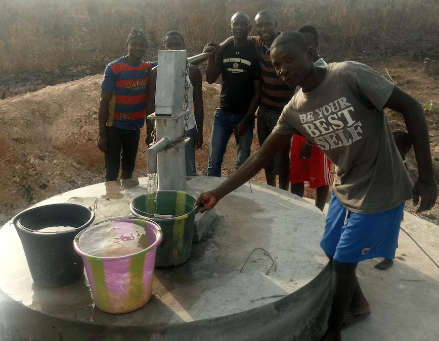 Men at clean water pump in Sierra Leone