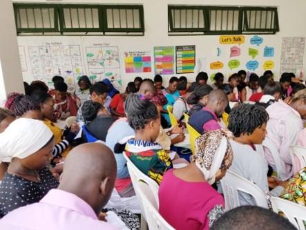 Teachers attending a training in Uganda