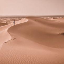 Tuareg walking on the soil desert