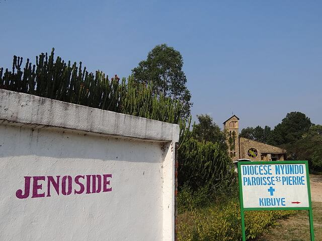 Kibuye Jenoside : Genocide Sign with Facade of Genocide Memorial Church, Karongi ,Western Rwanda