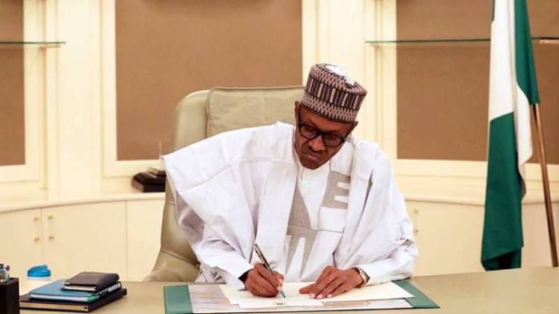 President Muhammadu Buhari of Nigeria signing an offficial document