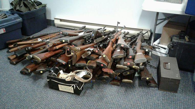 He accidentally calls 911 and arrested for 100 guns lying around