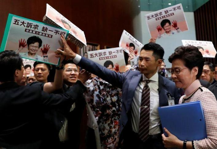 Chaos in Hong Kong parliament: government leader must abort speech after MPs protest