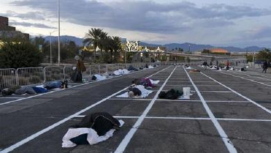 """Photo of Open-air car park in Las Vegas becomes temporary homeless shelter """"while 150,000 hotel rooms are empty"""""""