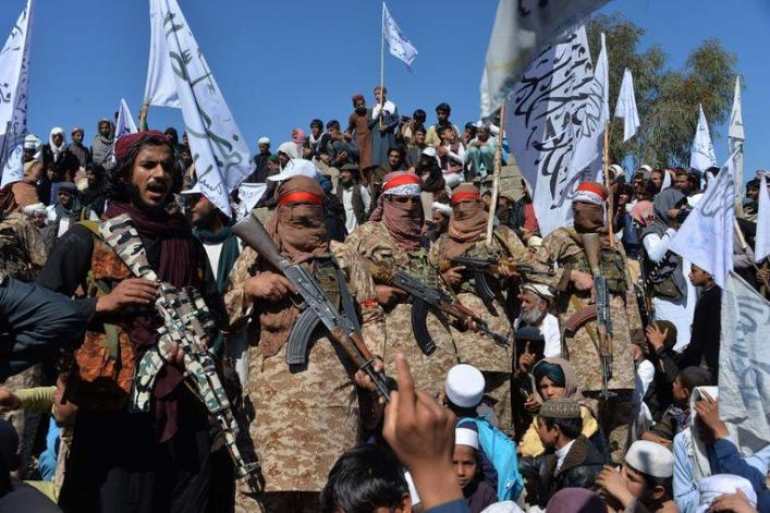Taliban fighters came together yesterday to celebrate the peace agreement.