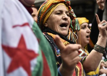 Algerians chant slogans as they take part in an anti-government demonstration in the center of the capital Algiers on January 10, 2020. RYAD KRAMDI / AFP