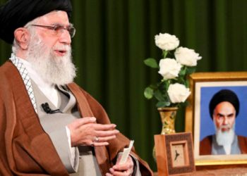 A handout picture provided by the office of Iran's Supreme Leader Ayatollah Ali Khamenei on March 22, 2020 shows him delivering a speech, with a portrait of the late founder of the Islamic Republic Ayatollah Ruhollah Khomeini on his left, in the capital Tehran. All 31 of Iran's provinces have reported cases, with the northeastern province of Semnan reporting the largest number of infections per capita. KHAMENEI.IR / AFP