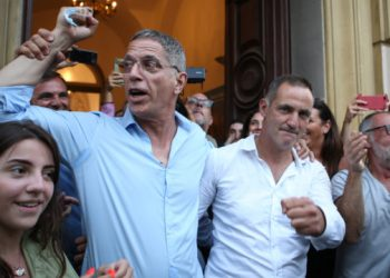 Bastia's mayor Pierre Savelli (2ndL) celebrates his reelection in the second round of the mayoral elections with president of the Corsican Assembly Gilles Semeoni (2ndR) and members of Savelli's list in Bastia on the French Mediterranean island of Corsica on June 28, 2020. (Photo by Pascal POCHARD-CASABIANCA / AFP)