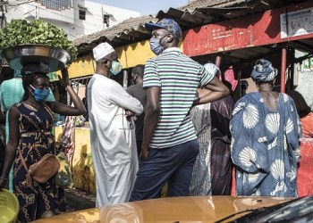 Senegalese are seen buying meat at a market in Dakar on May 23, 2020, on the eve of the Islamic festivity of Korite. Korite marks the end Muslim Holy month of Ramadan. – . (Photo by JOHN WESSELS / AFP)