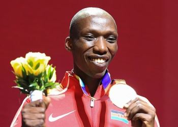 FILE PHOTO: Kenya's Timothy Cheruiyot poses on the podium during the medal ceremony for the Men's 1500m at the 2019 IAAF Athletics World Championships at the Khalifa International stadium in Doha. (Photo by MUSTAFA ABUMUNES / AFP)