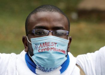 A protester wearing a protective mask takes part in a demonstration against suspected corruption in the response of the Kenyan government to the coronavirus disease (COVID-19) outbreak, in Nairobi, Kenya, August 21, 2020. REUTERS/Baz Ratner