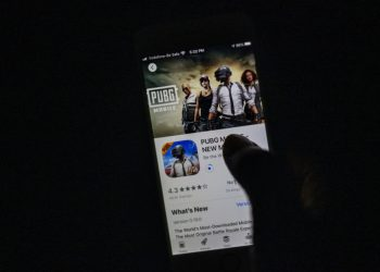 """A man looks at the """"PUBG Mobile"""" game, owned by Chinese internet giant Tencent, in the App Store on an Apple iPhone in New Delhi on September 2, 2020. – India on September 2 banned 118 Chinese apps as it stepped up economic hostilities over an increasingly bitter border showdown between the giant neighbours. (Photo by Jewel SAMAD / AFP)"""