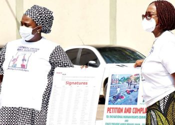 The convener, Mothers United and Mobilised (MUM), Dr. Boluwaji Onabolu (right); and a member, Mrs. Fatima Mohammed-Koro, taking the group's petition on brutality against innocent Nigerians to the National Human Rights Commission in Abuja…yesterday PHOTO: NAN