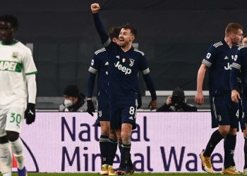 Juventus' Welsh midfielder Aaron Ramsey (C) celebrates after scoring during the Italian Serie A football match Juventus vs Sassuolo on January 10, 2021 at the Juventus stadium in Turin. (Photo by Marco BERTORELLO / AFP)