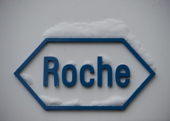 (FILES) In this file photo taken on February 01, 2012 shows the logo of Swiss pharmaceutical giant Roche in Basel. – Swiss pharma giant Roche said on March 15, 2021, it would pay $1.8 billion (1.5 billion euros) to buy US firm GenMark Diagnostics and thus broaden its rapid test portfolio, including for Covid-19. (Photo by SEBASTIEN BOZON / AFP)