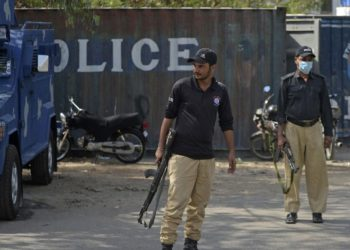Police stand guard near the French Consulate building to beef up security following a protest by extremist political party Tehreek-e-Labbaik Pakistan (TLP), in Karachi on April 15, 2021. Rizwan TABASSUM / AFP