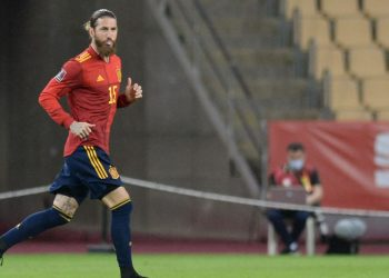 Spain's defender Sergio Ramos runs onto the field during the FIFA World Cup Qatar 2022 qualification football match between Spain and Kosovo at La Cartuja Olympic stadium in Seville on March 31, 2021. (Photo by CRISTINA QUICLER / AFP)
