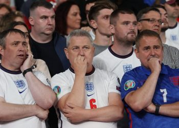 England fans look on during the UEFA EURO 2020 final football match between Italy and England at the Wembley Stadium in London on July 11, 2021. (Photo by Carl Recine / POOL / AFP)