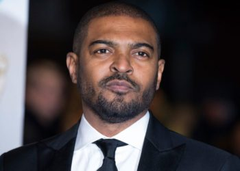 Noel Clarke poses for photographers upon arrival at the BAFTA Film Awards in London, Sunday, Feb. 10, 2019. (Photo by Vianney Le Caer/Invision/AP)